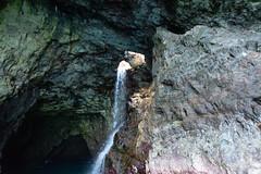 Waterfall hole Na Pali Coast Kauai Hawaii