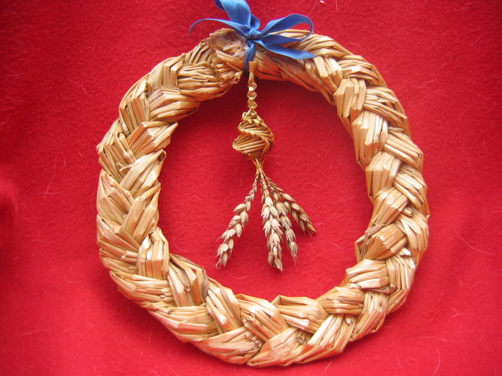 A Scandinavian-style harvest wreath made of woven straw.