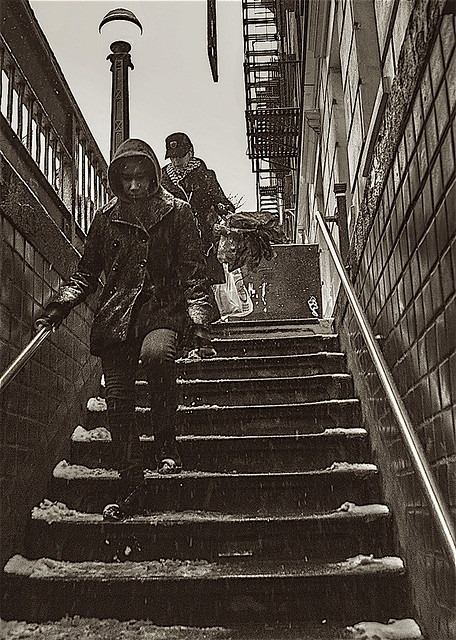 Candid of People Gingerly Walking Down Subway Steps on a Wintry Cold Snowy Day