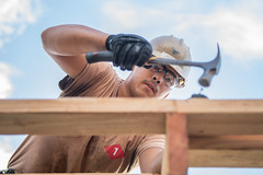TINIAN, Northern Mariana Islands (Dec. 12, 2018) Builder 3rd Class Jesse Martinez, from Omaha, Neb., assigned to Naval Mobile Construction Battalion 1, Detachment Guam, hammers a purlin to the roof of a home. Service members from Joint Region Marianas and U.S. Indo-Pacific Command are providing Department of Defense support to the Commonwealth of the Northern Mariana Islands' civil and local officials as part of the Federal Emergency Management Agency-supported Super Typhoon Yutu recovery efforts. (U.S. Navy photo by Mass Communication Specialist 2nd Class Kelsey J. Hockenberger)