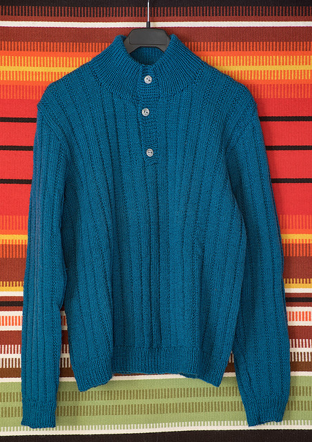 Jumper with metal buttons