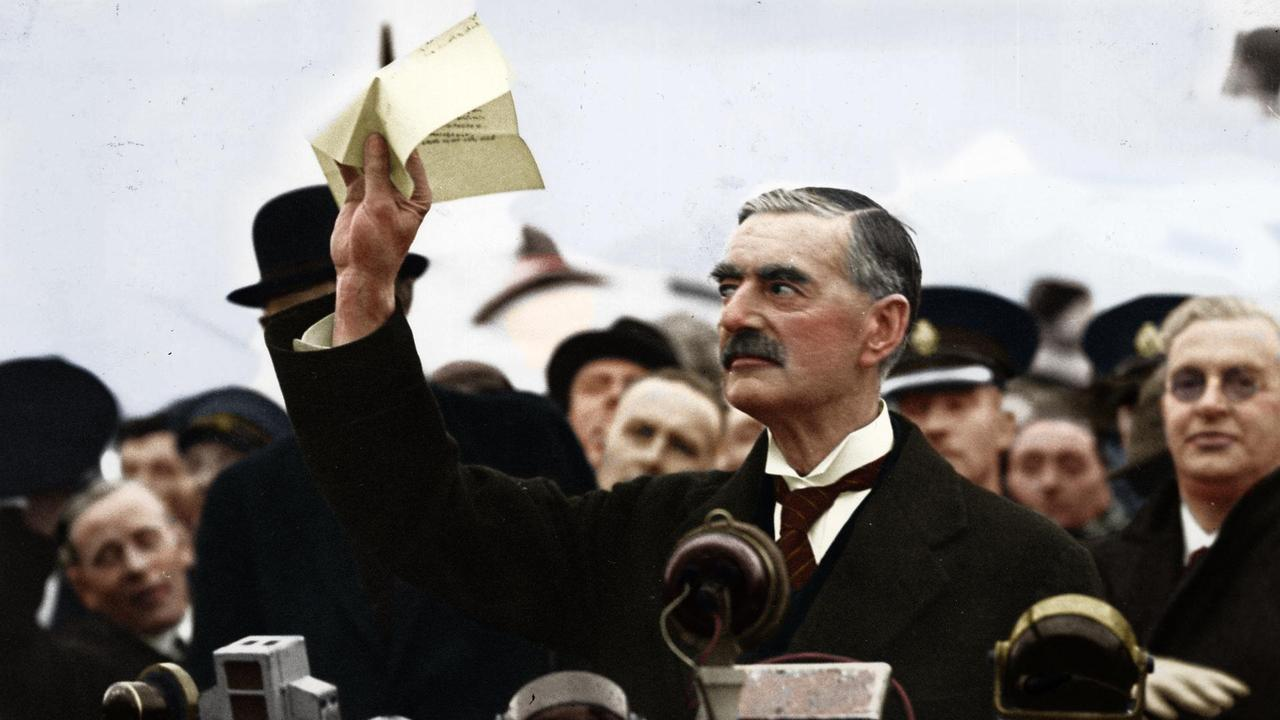 """Neville Chamberlain returning from Germany with the piece of paper signed by Hitler which would bring """"peace for our time"""" September 30th, 1938."""