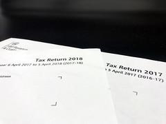 2 tax return forms, a 2018 tax return form and 2017 tax return form.