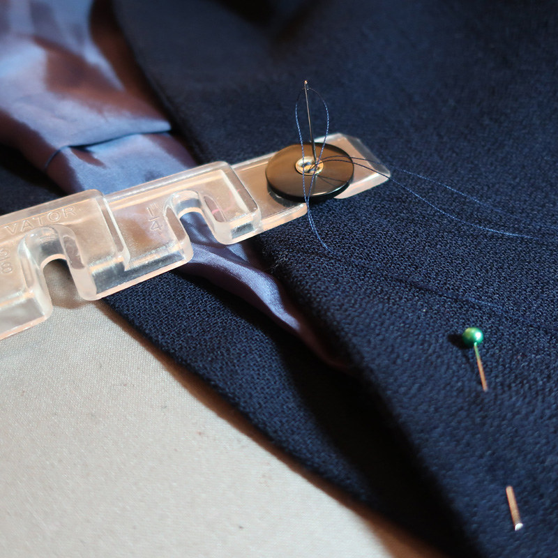 Navy blazer button sewing