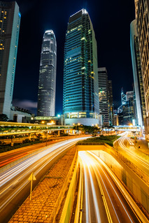Traffic at central district in Hong Kong at sunset time. Car light trails and urban landscape in Hong Kong .