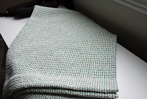 Finished handwoven cotton basket weave baby blanket in white cotton slub and plain weave 8/4 cotton pressed and folded by irieknit