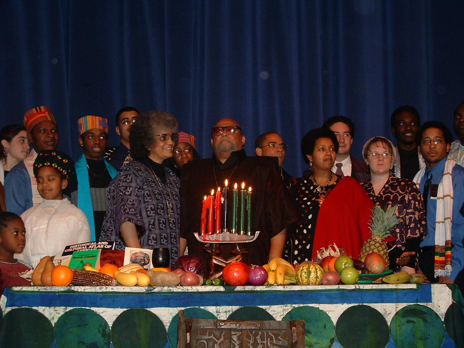 A 2003 Kwanzaa celebration with Kwanzaa founder Maulana Karenga at center, and others.