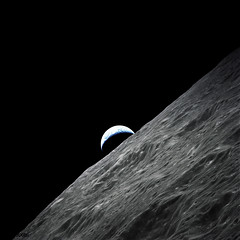Crescent Earth rises above the lunar horizon taken during the Apollo 17 mission. Original from NASA. Digitally enhanced by rawpixel.