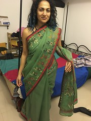 in Neeta's beautiful green embroidered sari