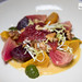 Baby beet and kale salad, cranberries, walnuts, beet leaf pistou, orange dressing