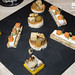 Salmon and cream cheese toasts, toasts with foie gras, apple and walnut, and polenta with sardines in saor on top