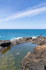 Discovering a Rock pool Queen's Bath Princeville Kauai Hawaii