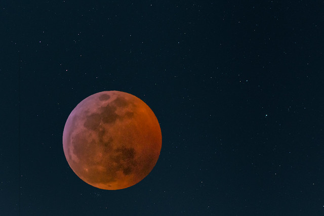 Eclipsed moon in the starfield