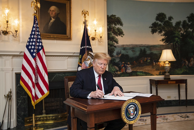 President Donald J. Trump signs a Presidential Proclamation