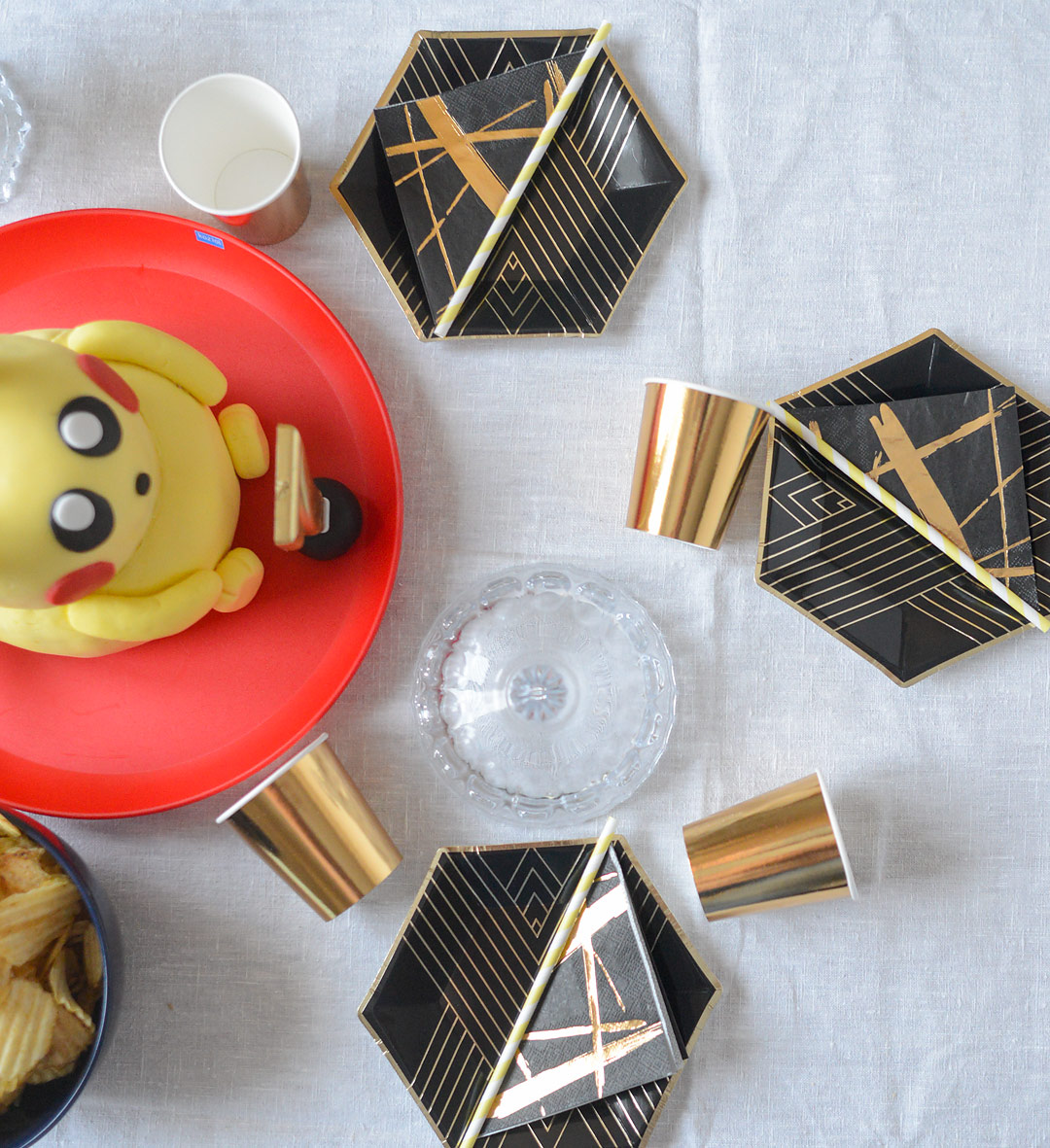 Pokemon birthday party with Pikachu cake and black & gold tableware