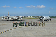Adm. Phil Davidson, commander of U.S. Indo-Pacific Command, and Adm. Katsutoshi Kawano, Japan Self-Defense Force Chief of Staff, Joint Staff, pose with members of U.S. Navy and Japan Maritime Self-Defense Force patrol squadrons during a visit to Kadena Air Base in Okinawa, Nov. 6. (U.S. Navy/MC1 Kevin A. Flinn)