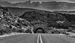 A Graveled Road Leading off to Peaks of the Sierra del Carmen (Black & White, Big Bend National Park)