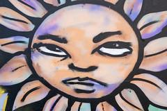 Sun flower face graffiti