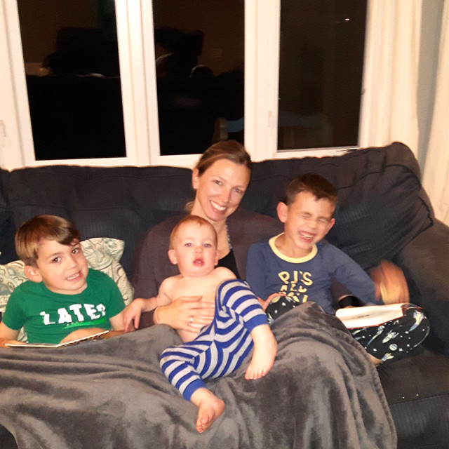 Claire cuddled on the couch with all three nephews.