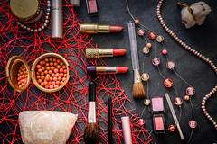 Women's cosmetics on a dark graphite background