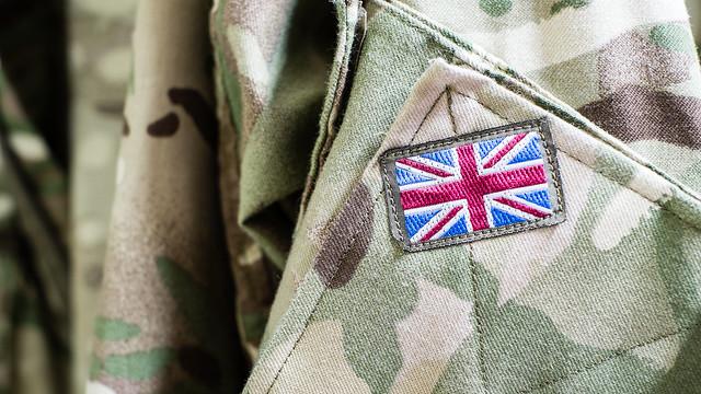 Union Jack flag on the sleeve of British military camouflage uniform shirt sleeve