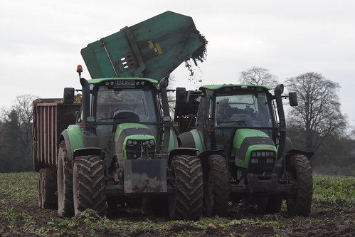 Deutz Fahr Agrotron TTV 1160 Tractor with an Armer Salmon Beever Twin Row Beet Harvester loading to a Lee Trailer drawn by a Deutz Fahr Agrotron 6180 C-Shift Tractor
