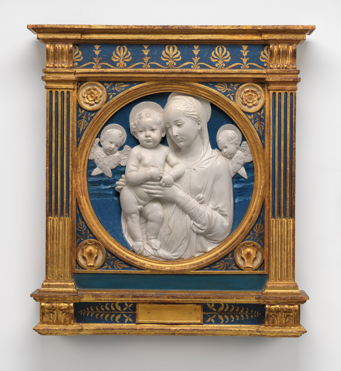 Madonna and Child with Cherubim by Andrea della Robbia, glazed terra cotta, circa 1485. Currently in the collections of the National Gallery of Art, Washington, D.C.