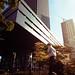A businesman walks past the Shenzhen Stock Exchange
