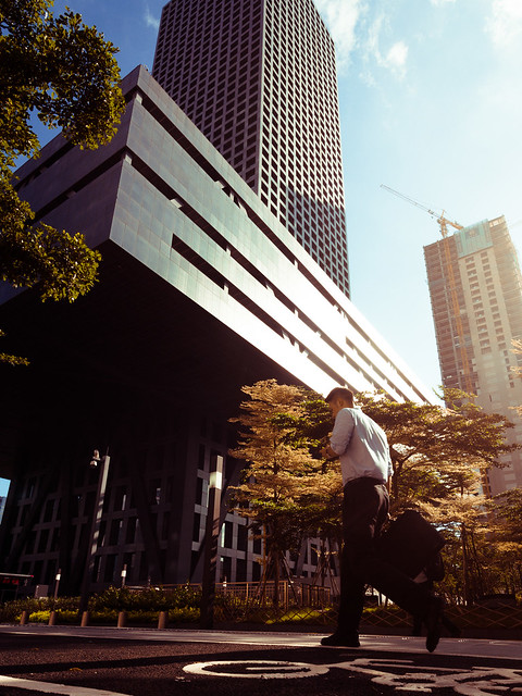 A businesman walks past the Shenzhen Stock Exchange