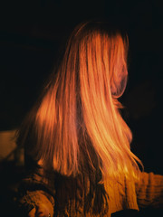 Girl with long blond hair dancing at a venue