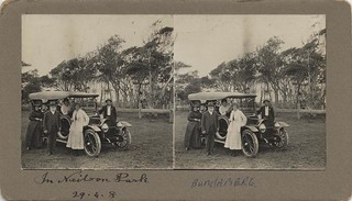 Group of people posing with a motor vehicle, Neilson Park, Bundaberg, 1908
