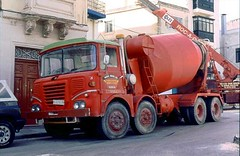 ergomammoth posted a photo:Dalli Brothers' Foden S40 eight-wheeled mixer was a bit of a beast. It was also a rarity on Malta, as I don't recall ever seeing another S40 cabbed Foden on the Island. Here she is delivering a load in a back-street in St. Julians in March 1993. When I next returned in 1995, the firm had finished. She was powered by a Gardner 180. Elsewhere in these pages is their other rarity; the Guy Big J8 mixer they also used to operate.