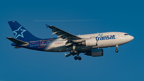30 year-old Air Transat Airbus A310 on the way in to Gatwick, gleaming in the winter sunshine.....