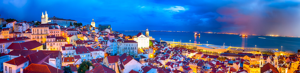 Amazing Picturesque Panoramic Image of The Oldest Alfama District in Lisbon in Portugal. Townscape Scenery Was Made During a Blur Hour