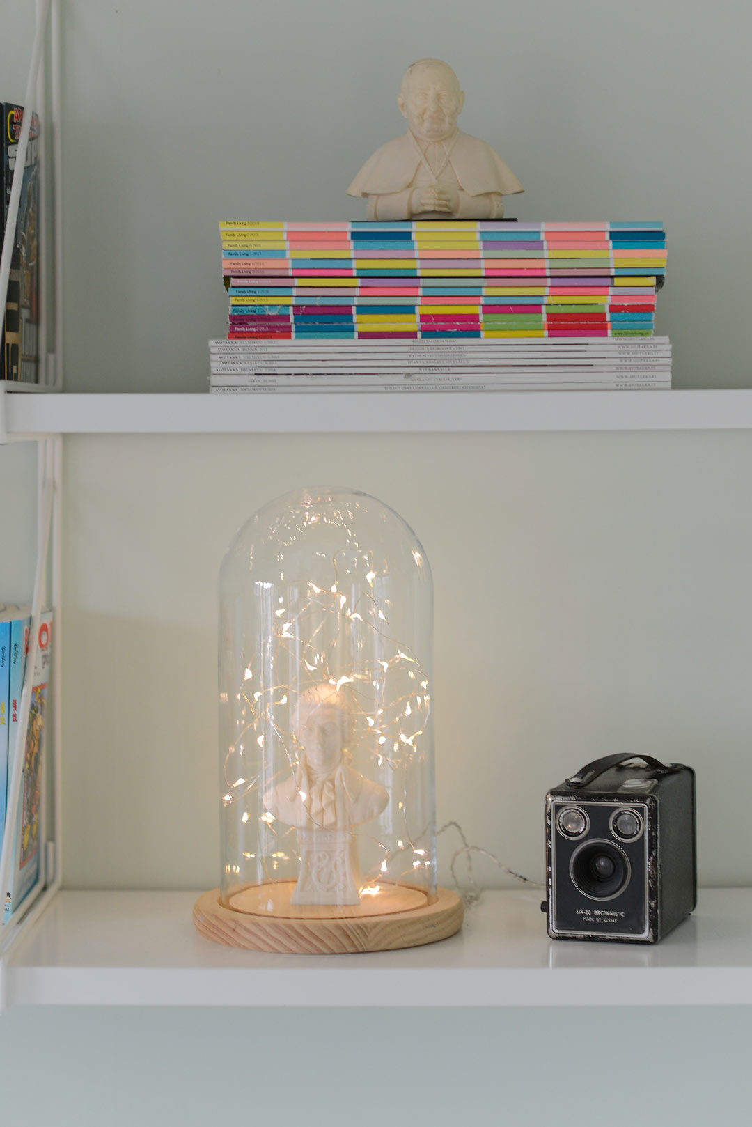 Shelfie with fairy lights in a glass dome