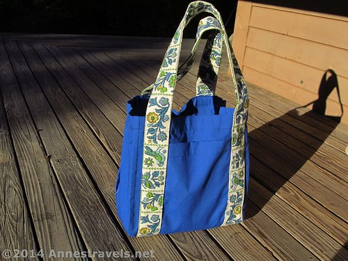 A side view of the water bottle tote bag