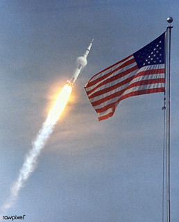 The American Flag heralds the flight of Apollo 11, man's first lunar landing mission. Original from NASA. Digitally enhanced by rawpixel.