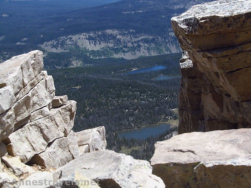 Looking through a rift in the edge of Bald Mountain - down on lakes in the High Uintas of Utah