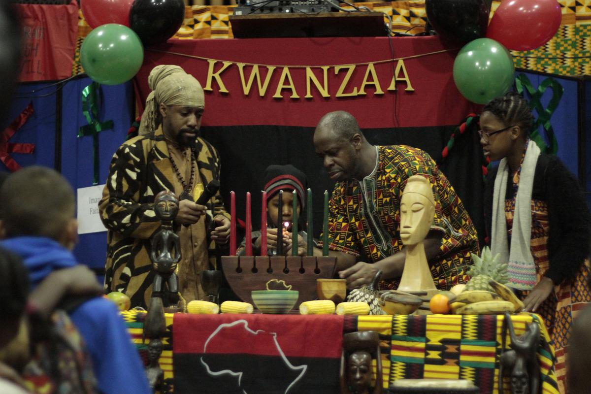 Lighting the Mishumaa Saba -- seven candles -- of Kwanzaa.