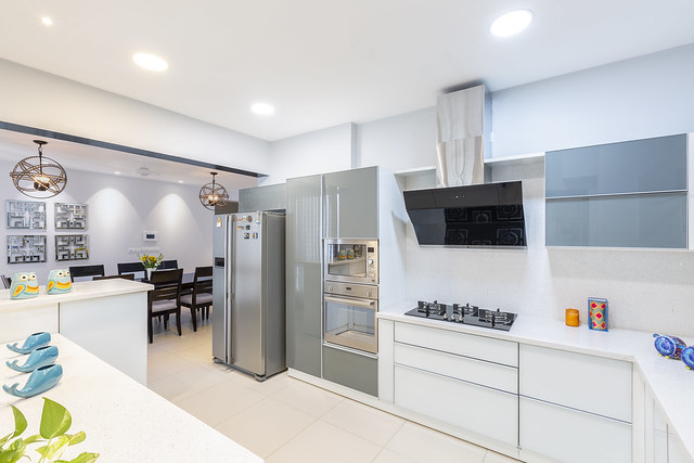 Modern modular white kitchen design with quartz countertop.