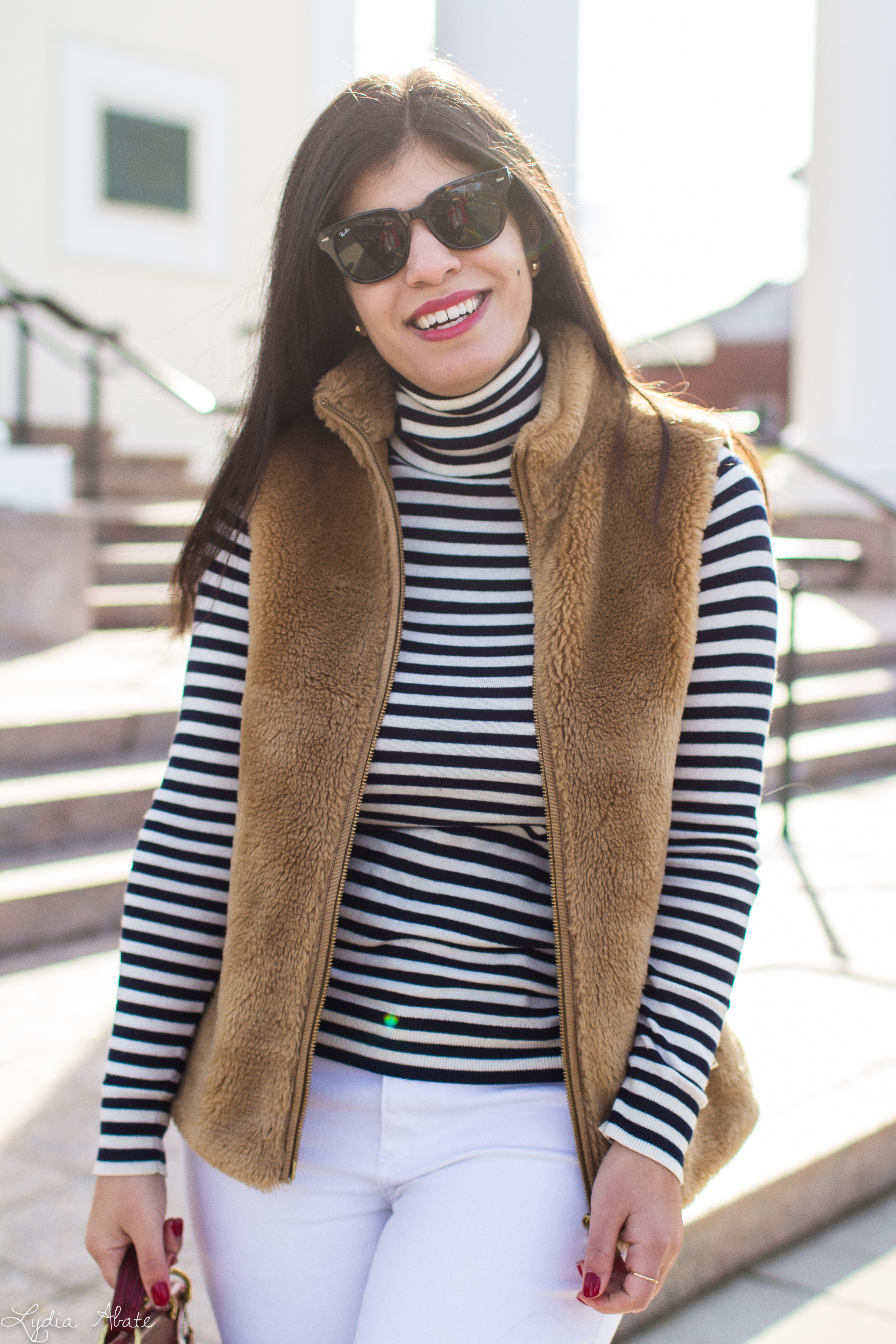 J.Crew plush excursion vest, striped shirt, white jeans, red Ferragamo bow pumps, coach bag-13.jpg