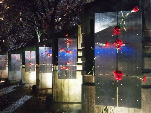 AIDS Memorial in red and white at night (5) #toronto #aidsmemorial #barbarahallpark #hiv #churchandwellesley #churchstreet #flowers #carnations #red #white