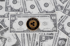 Ripple coin on a paper dollars money