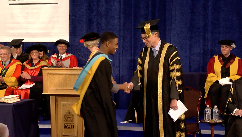 A student receiving his degree on stage at the Assembly Rooms