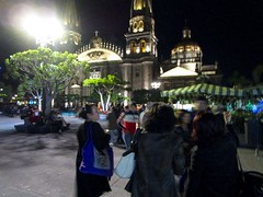 Rosie watches Rachel and Irene discussing where to eat in Guadalajara's central square