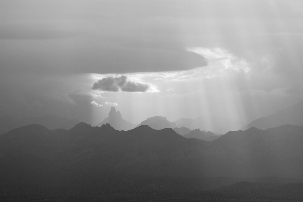 As rain passes to the north, sunlight breaks through the clouds to shine upon Weaver's Needle