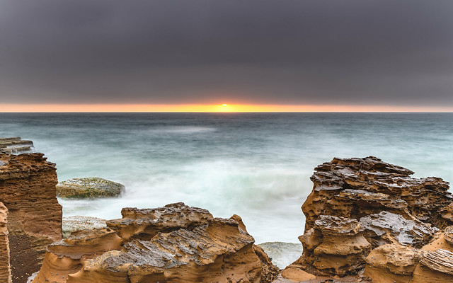 Overcast Coastal Seascape from Sandstone Headland