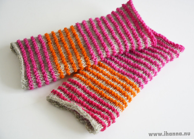 Knitted wrist-warmers in pink, gray and orange
