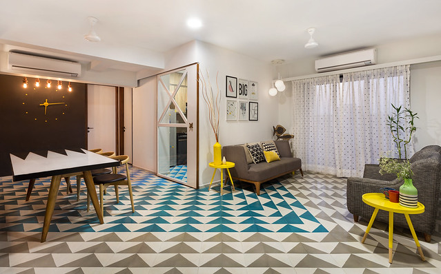 A quirky house with patterned cement tiles and a Backgammon inspired table