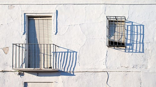 White Wall with barred Window and Balkony